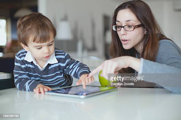 Mother with her son looking at a tablet