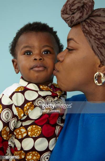 mother with her son - nerys jones stock photos and pictures