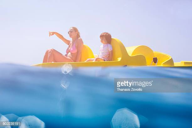 Mother with her son riding on paddle boat