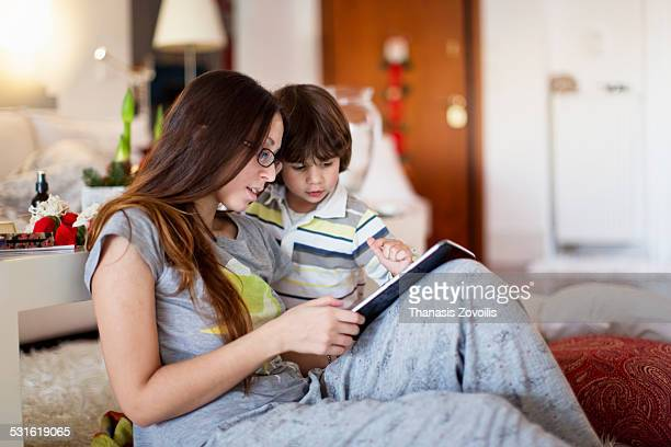 Mother with her son using a digital tablet