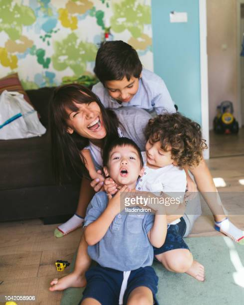 mother with her three little boys - nanny stock photos and pictures