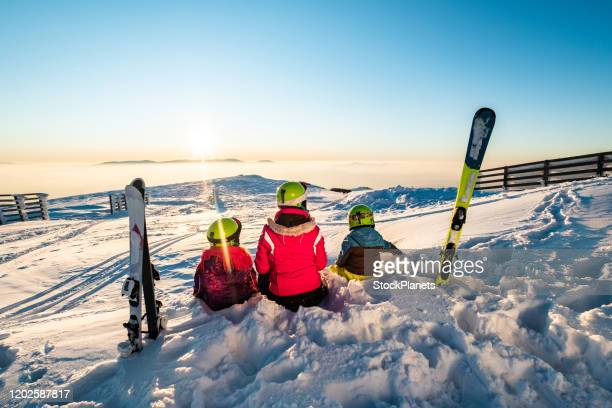 mother with kids on skiing - ski holiday stock pictures, royalty-free photos & images