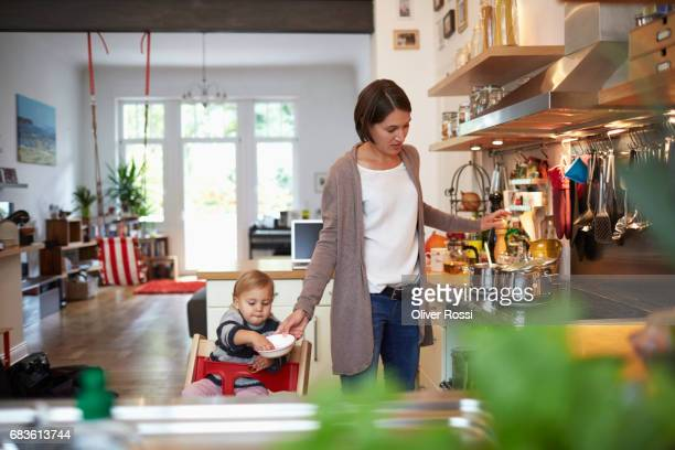 Mother with little daughter in kitchen