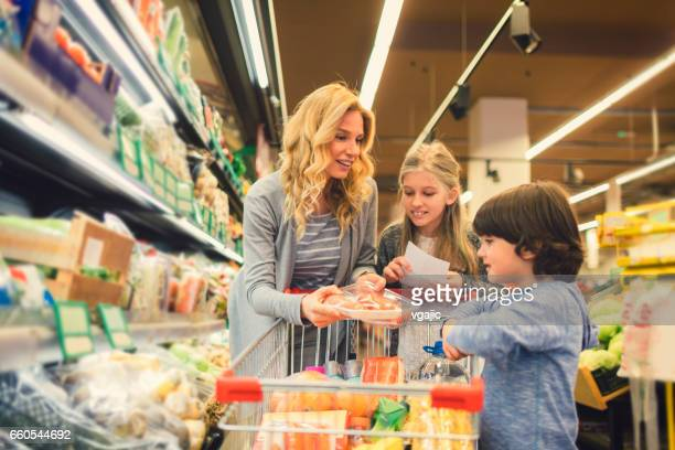 Mother with Son and Daughter In A Supermarket