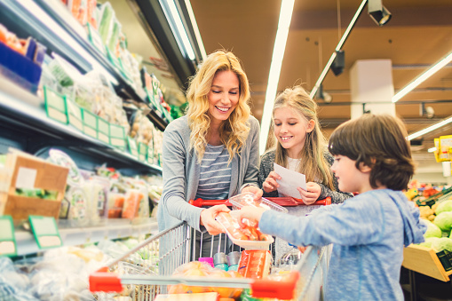 Mother with Son and Daughter In A Supermarket - gettyimageskorea