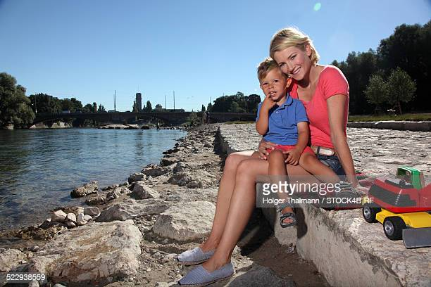 'Mother with son at River Isar, Munich, Germany'