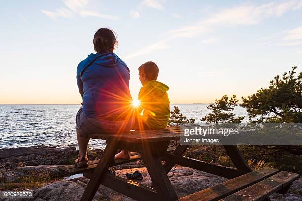 Mother with son at sunset