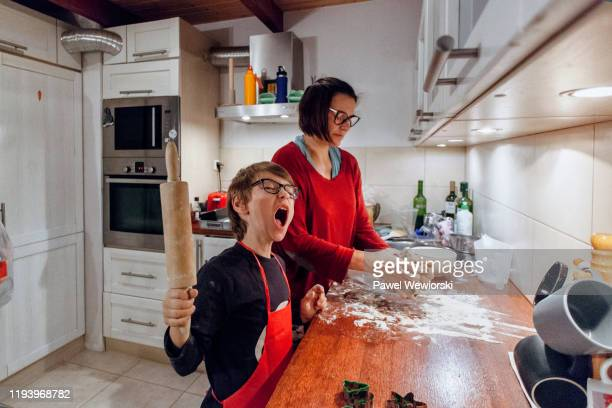 mother with son cooking - apron stock pictures, royalty-free photos & images