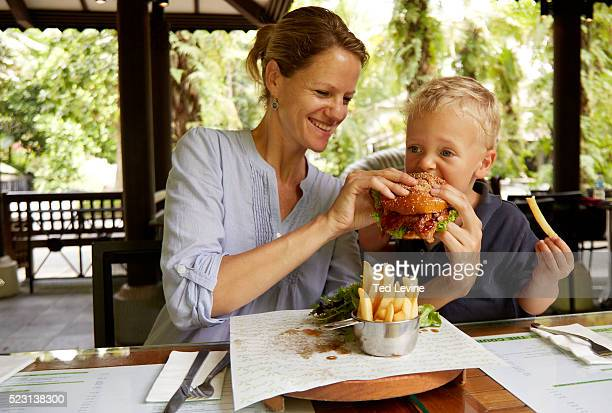 Mother with son (2-3) having lunch at terrace, Singapore
