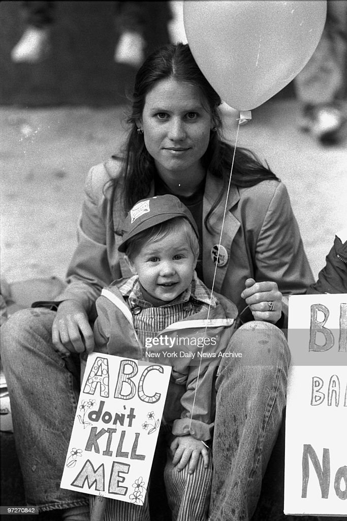 Mother with son hold sign, ABC don't KILL ME during anti-nuk : News Photo