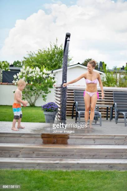 mother with son in garden - boys taking a shower stock pictures, royalty-free photos & images