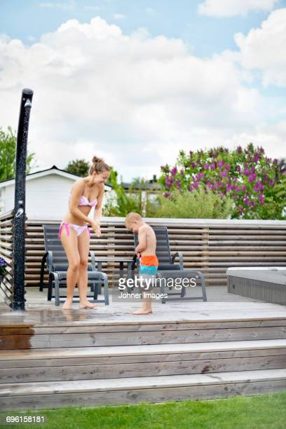 mother with son in garden - mother son shower stock photos and pictures