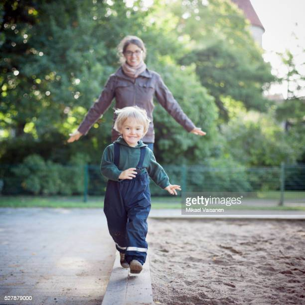 Mother with son on playground