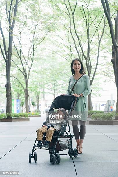 Mother with son sitting in stroller,  portrait