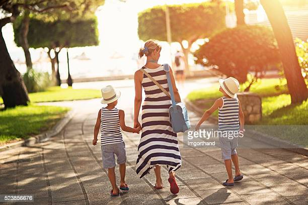 Mother with sons going to the beach