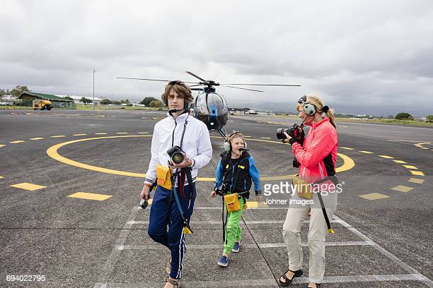 Mother with sons in front of helicopter