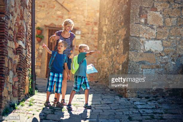 Mother with sons lost in italian town in Tuscany