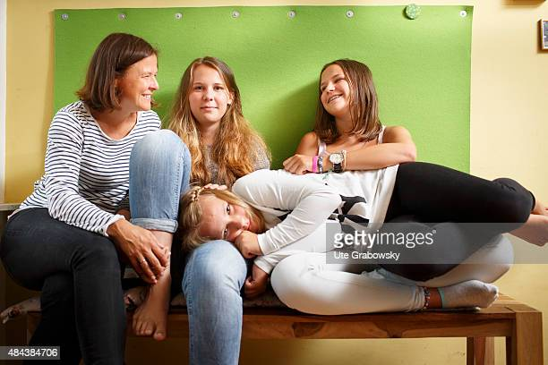 Mother with three daughters sitting on a bench on August 10 2015 in Bonn Germany
