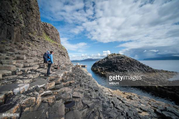 mother with toddler boy son in baby backpack on staffa - rock baby sleep stock pictures, royalty-free photos & images