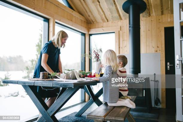 mother with two child using watercolour paints during christmas - scandinavia stock pictures, royalty-free photos & images