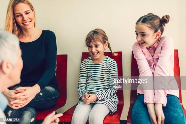 Mother with two daughters at dentist office