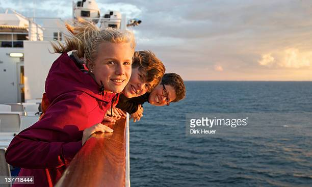 mother with two daughters at rail - ferry stock photos and pictures