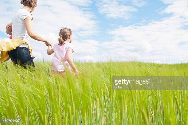 Mother with two daughters in field