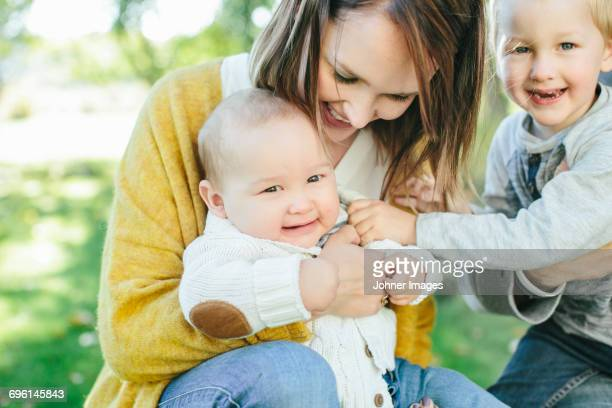 mother with two sons - family with two children stock photos and pictures