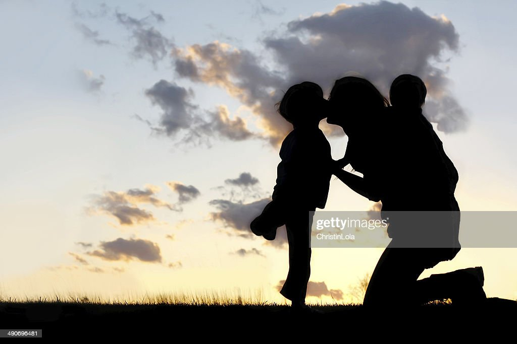 Mother with Two Young Children Hugging and Kissing : Stock Photo