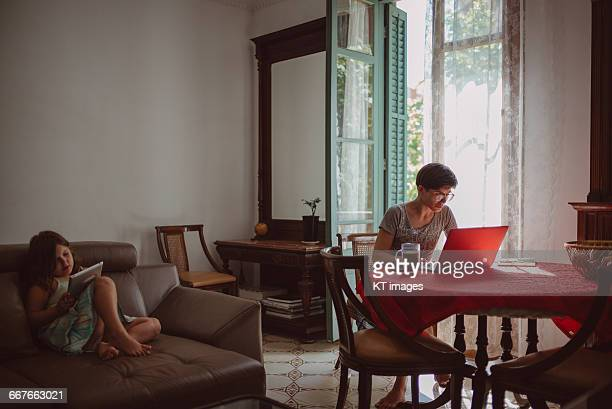 mother working from home - working mother stock pictures, royalty-free photos & images