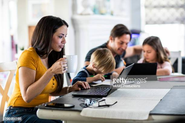 mother working from home while children attend school online - parent stock pictures, royalty-free photos & images