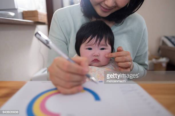 Mother working from home with baby