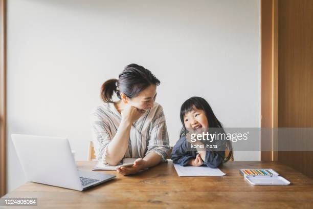 mother working from home with daughter - two generation family stock pictures, royalty-free photos & images
