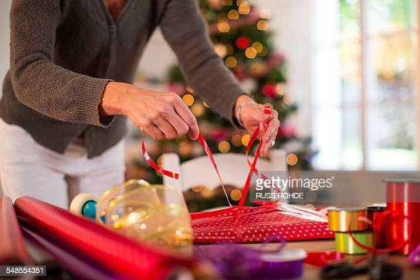 Mother wrapping Christmas presents