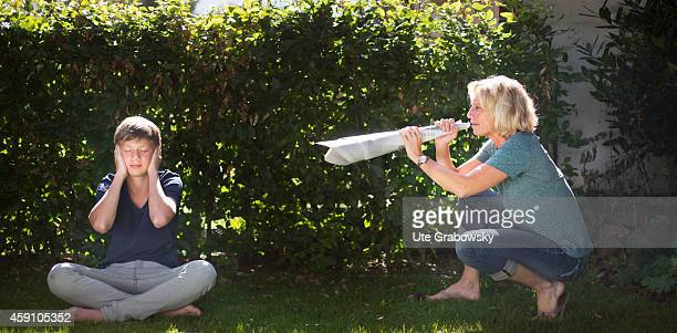Mother yelling through a megaphone made out of rolledup newspapers at her son on August 11 in Duelmen Germany Photo by Ute Grabowsky/Photothek via...