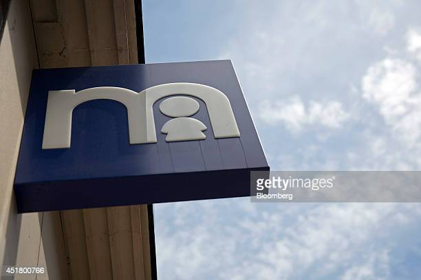 A Mothercare logo sits on a blue sign above the entrance to a Mothercare Plc store on Oxford Street in London UK on Monday July 7 2014 Destination...
