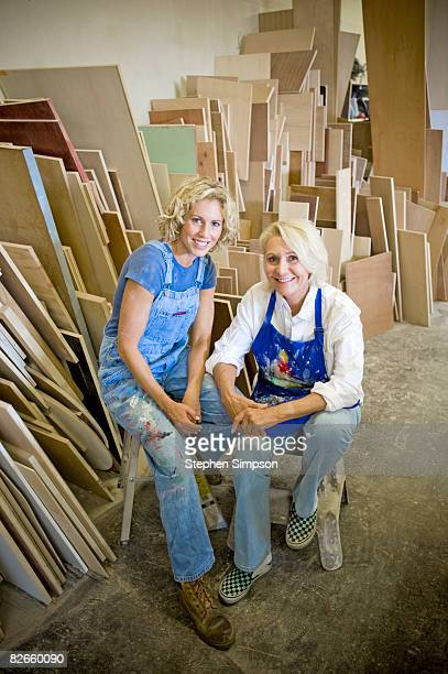 mother/daughter [or business partners] in workshop
