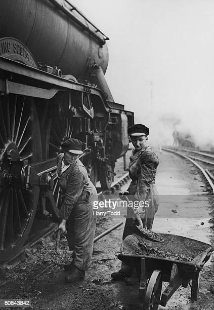 A motherdaughter team work at the LNER Locomotive Depot at King's Cross Station London after both their husbands have been drafted into the armed...