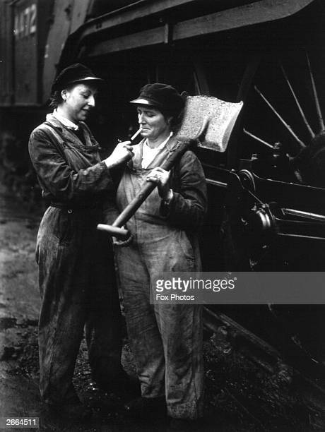 A motherdaughter team working at the locomotive depot at King's Cross Station London after both their husbands have been drafted into the armed...