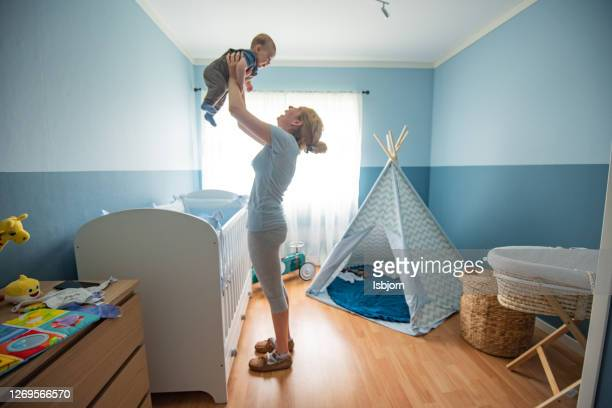 motherly love. - brightly lit stock pictures, royalty-free photos & images