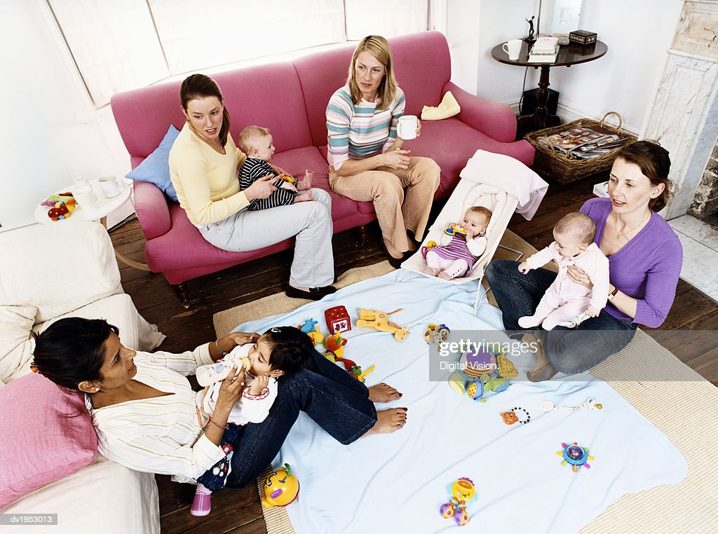 Mothers and Babies in a Sitting Room : Stock Photo