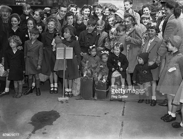 Mothers and children at a London railway station after the children had arrived from Leicester on the first 'Homeward Special' train bringing...