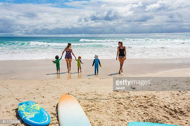 Mothers and Children at the Beach With Sun Protection