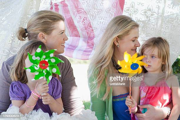Mothers and children with pinwheels