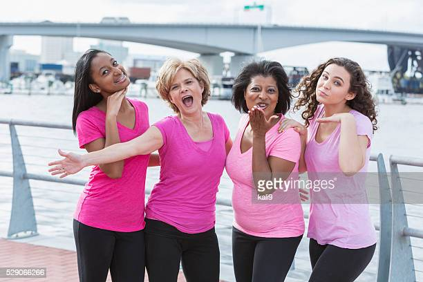 mothers and daughters for breast cancer awareness - social awareness symbol stock photos and pictures