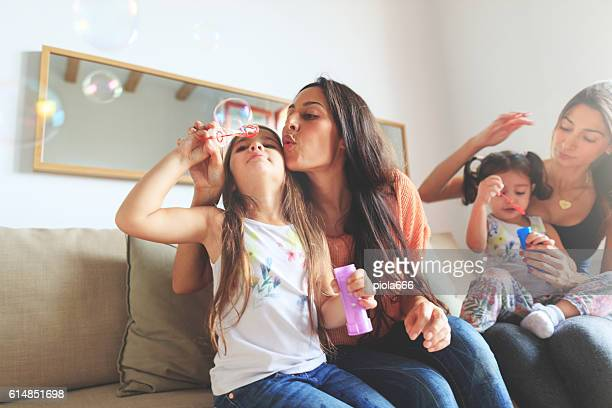 Mothers and daughters having fun together at home