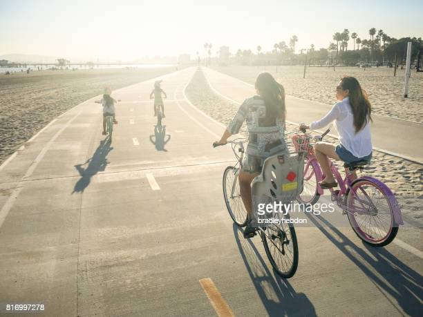 Mothers and daughters ride bikes in Long Beach, CA