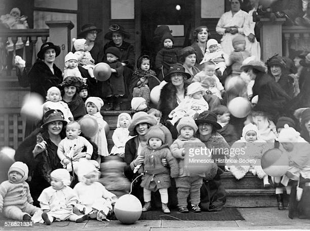 Mothers and infants gather on the stoop of the Cathedral of St Paul for the Better Baby Contest in the 1920s Mrs A J Gillette who sponsored the event...