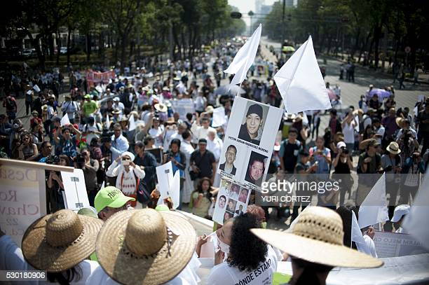 Mothers and other relatives of missing people participate in a march to demand to the government to clarify the disappearance of their loved ones in...