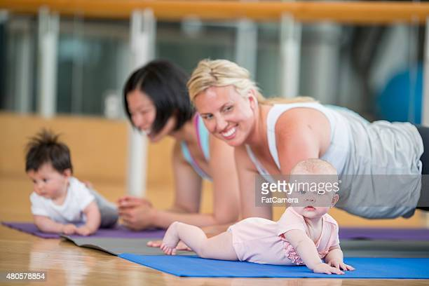 mothers and their babies at excercise class - community centre stock pictures, royalty-free photos & images